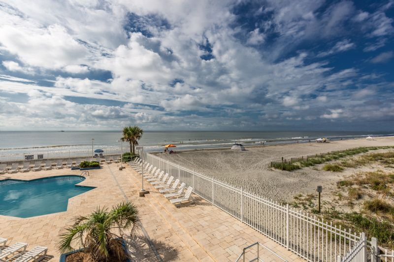 Chas. Oceanfront Villas 123 - Sunset on the Rox | Photo 1